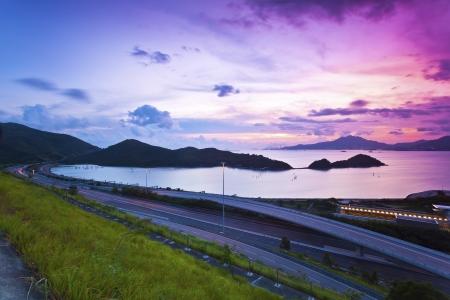 Traffic highway in Hong Kong at sunset photo