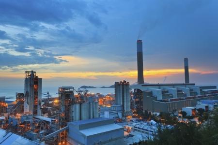Power plants in Hong Kong at sunset Imagens