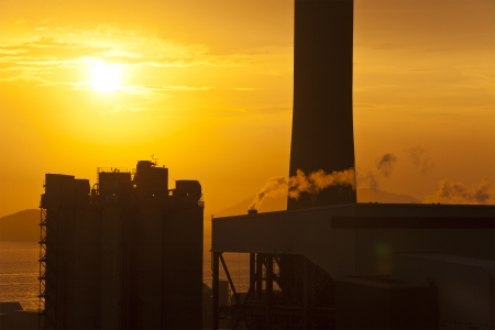 Air pollution from factories in sunset photo