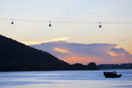 Sunset with cable cars background along coast in Hong Kong photo