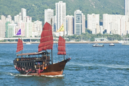 Junk boat in harbour of Hong Kong photo