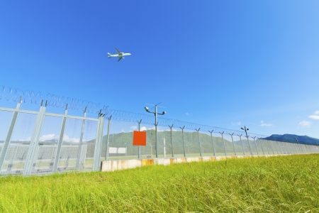 Airplane fly over grass in Hong Kong photo