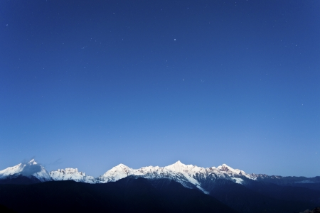 Snow mountain at dawn with stars photo