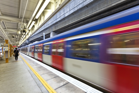railway station: Abstract movement of train, blurred motion. Stock Photo