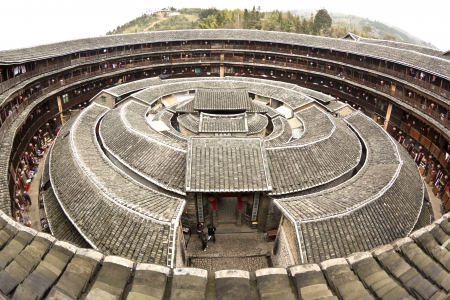 brick earth: Fujian Tulou house in China. It is the Chinese rural dwellings of the Hakka and others in the mountainous areas in southeastern Fujian, China.