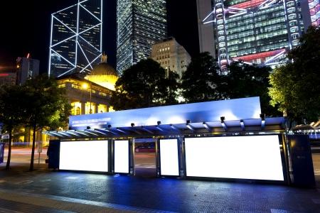 Blank billboard at night Imagens