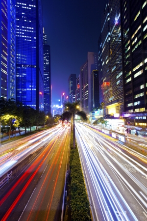 Busy traffic at downtown city at night Stock Photo