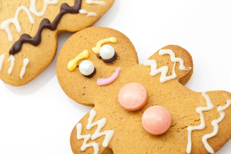 Ginger bread man isolated on white background photo