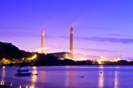 Power plant along coast at sunset photo