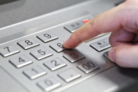 financial services: Human hand enter atm banking cash machine pin code