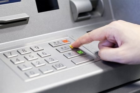 withdraw: Human hand using ATM machine