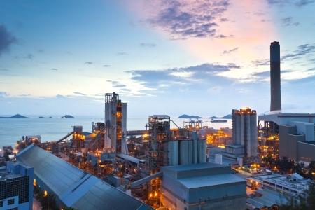 Sunset at power plant in Hong Kong Imagens