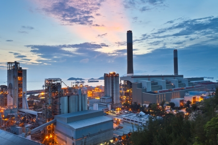 Power plant at sunset along coast Stock Photo