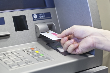 cashpoint: Hand taking money on ATM bank machine Stock Photo