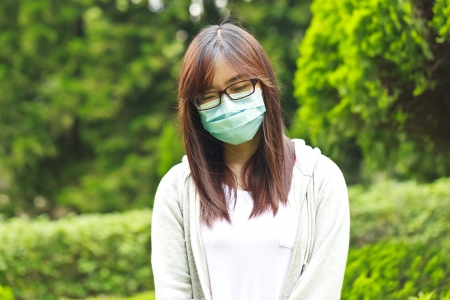 deterrence: Woman wearing mask in park