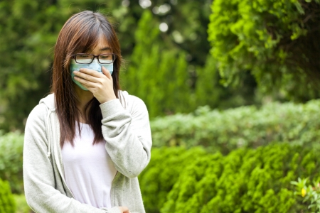 contagion: Woman wearing mask Stock Photo