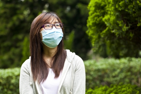 facemask: Woman wear facemask outdoor Stock Photo
