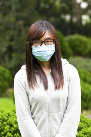 deterrence: Woman wearing medical face mask