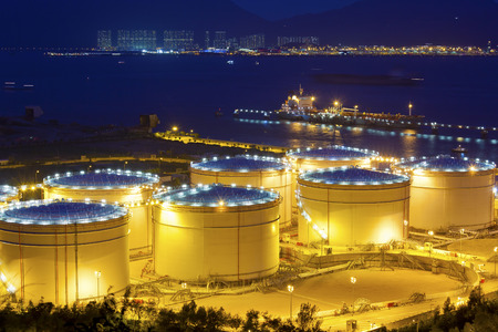 Big Industrial oil tanks in a refinery at night Editorial