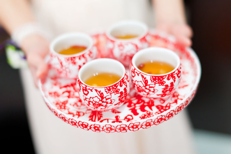 chinese tea cup: Chinese tea ceremony cups in wedding day Stock Photo