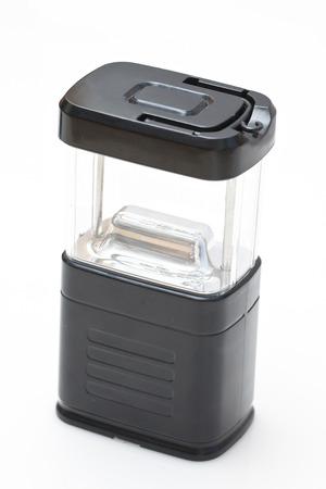 Black camping light on white background photo