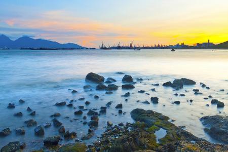 Sunset along coast with sea stones photo