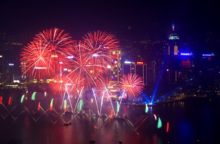 lasted: HONG KONG - 1 JANUARY: A splendid firework show and countdown celebration held in Hong Kong on 1 January, 2014. The show lasted for 8 minutes and lighted up the skies above Hong Kong skyscrapers.