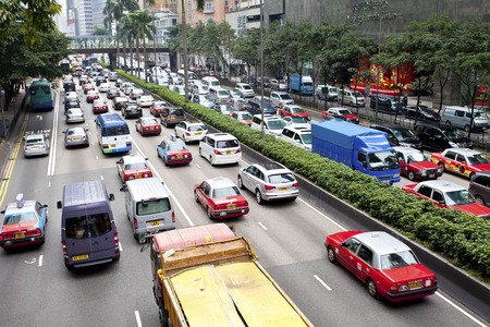 HONG KONG - FEB 9, Traffic jam at Wan Chai, Hong Kong on 9 Feburary, 2014.  It is one of the busiest district in Hong Kong