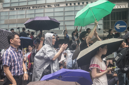 insist: HONG KONG - JUNE 20: Protesters gathered outside the government headquarters on June 20, 2014 in Hong Kong. The Finance Committee is vetting a funding request about northeast New Territories. Editorial
