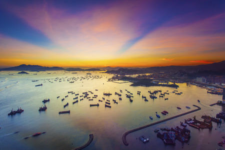 Sunset at container terminal in Hong Kong Imagens