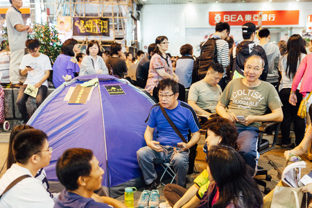 umbrella month: HONG KONG, OCT 24: Umbrella Revolution in Mongkok on 24 October 2014. Hong Kong people last this movement for a month and set up many tents in occupied zone. Editorial