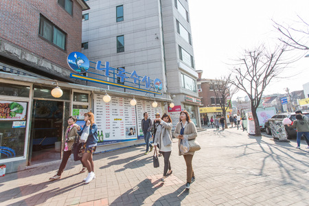 city fish market sign: SEOUL - MARCH 27: Hongdae Area, Hongik on March 27 2015, in Seoul, South Korea. It is a place to show art and famous shopping district. Editorial
