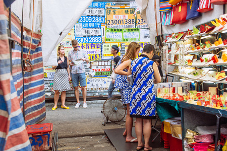 hawker: HONG KONG - Oct 3: Unidentified hawker selling goods in Fa Yuen Street, Mongkok, Hong Kong on October 3, 2015.