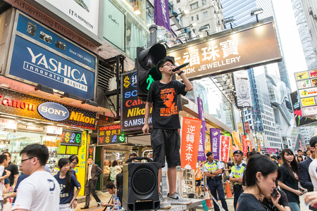 promoting: HONG KONG - JUN 4: The meeting to memorize The Tiananmen Square protest of Beijing at 1989 on June 4, 2015 in Hong Kong. Joshua Wong of Scholarism of Hong Kong is promoting.