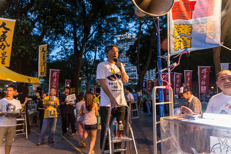 promoting: HONG KONG - JUN 4: The meeting to memorize The Tiananmen Square protest of Beijing at 1989 on June 4, 2015 in Hong Kong. Hong Kong Alliance in Support of Patriotic Democratic Movements in China is promoting the event.