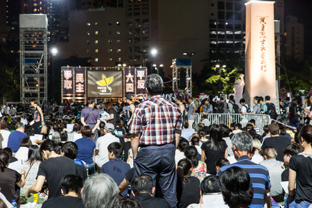 marchers: HONG KONG - JUN 4: People join the Memorials for the Tiananmen Square protests of 1989 in Victoria Park on 4 June 2015. According to the organization, 135,000 people attented the 26th anniversary.