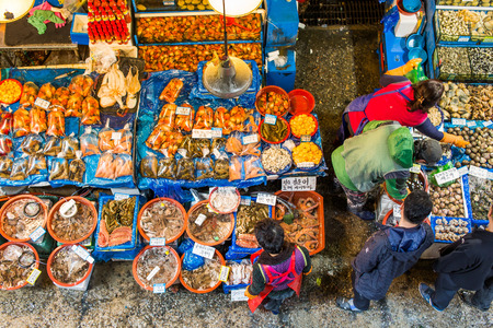 fisheries: SEOUL - MAR 28: Aerial view of shoppers at Noryangjin Fisheries Wholesale Market March 28, 2015 in Seoul, South Korea. The 24 hour market has over 700 stalls selling fresh and dried seafood. Editorial