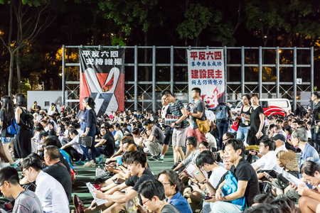 overcrowded: HONG KONG - JUN 4: People join the Memorials for the Tiananmen Square protests of 1989 in Victoria Park on 4 June 2015. According to the organization, 135,000 people attented the 26th anniversary.