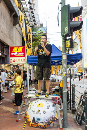 memorize: HONG KONG - JUN 4: The meeting to memorize The Tiananmen Square protest of Beijing at 1989 on June 4, 2015 in Hong Kong. Different parties are promoting along the street before the commencement of the event.