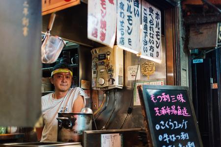 TOKYO, JAPAN - AUG 4: Shinjuku food stalls at night in Tokyo, Japan on August 4, 2015. The Japanese stalls are traditional and many local people enjoy after work at night. Editorial