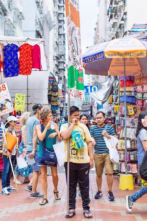 HONG KONG - Oct 3: Unidentified hawker selling goods in Fa Yuen Street, Mongkok, Hong Kong on October 3, 2015.