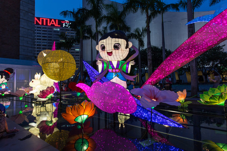 HONG KONG - SEP 19: Chinese lanterns light up to celebrate the mid-autumn festival, also known as moon festival, on September 19, 2015 in Tsim Sha Tsui, Hong Kong.