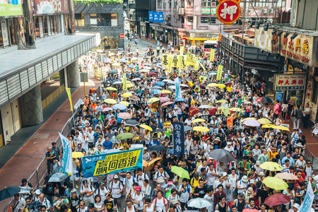 suffrage: HONG KONG - JULY 1: Hong Kong people seek greater democracy as frustration grows over the influence of Beijing on July 1, 2015 in Hong Kong. Organizers of protest claimed a turnout of 48,000 people.