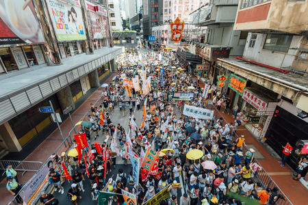 HONG KONG - JULY 1: Hong Kong people seek greater democracy as frustration grows over the influence of Beijing on July 1, 2015 in Hong Kong. Organizers of protest claimed a turnout of 48,000 people.