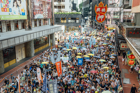 turnout: HONG KONG - JULY 1: Hong Kong people seek greater democracy as frustration grows over the influence of Beijing on July 1, 2015 in Hong Kong. Organizers of protest claimed a turnout of 48,000 people.