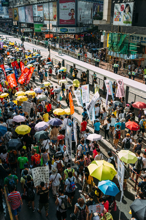 turnout: HONG KONG - JULY 1: Hong Kong people show their dissatisfaction to the Hong Kong government by march on July 1, 2015 in Hong Kong. Organizers of protest claimed a turnout of 48,000 people. Editorial