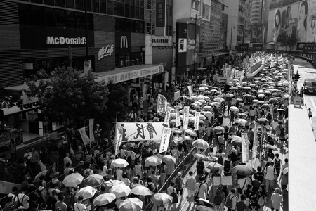 suffrage: HONG KONG - JULY 1: Hong Kong people show their dissatisfaction to the Hong Kong government by march on July 1, 2015 in Hong Kong. Organizers of protest claimed a turnout of 48,000 people. Editorial