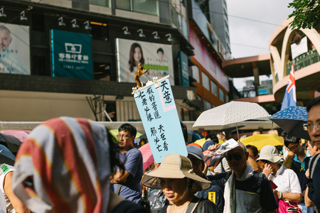 dissatisfaction: HONG KONG - JULY 1: Hong Kong people show their dissatisfaction to the Hong Kong government by march on July 1, 2015 in Hong Kong. Organizers of protest claimed a turnout of 48,000 people. Editorial