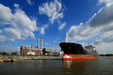 commercial docks: large tanker ship oil transport, A ship in refinery port Stock Photo