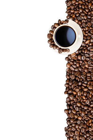 Cup of coffee and coffee beans isolated on white.